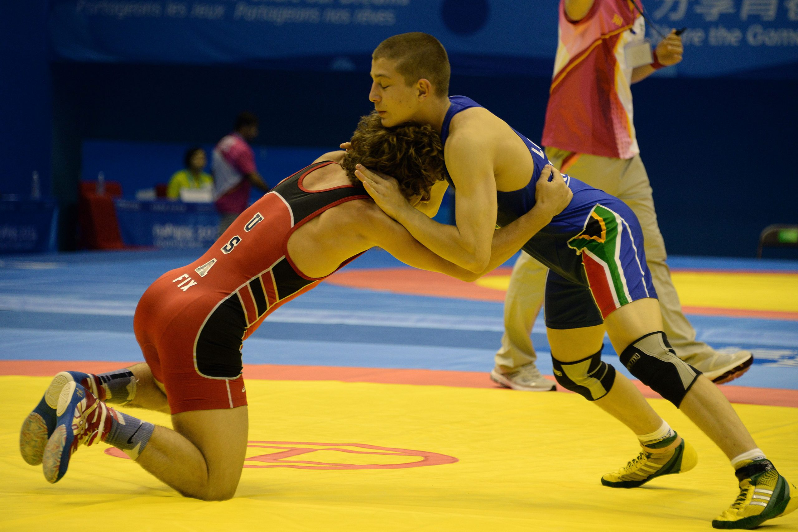 Win apiece but it's tough for SA wrestlers at YOG