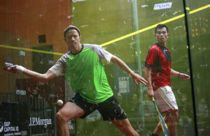Coppinger of South Africa and Ong of Malaysia compete in their men's singles squash match during the 2014 JP Morgan Tournament of Champions in New York
