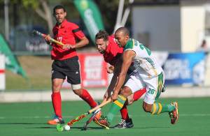 SA striker Natius Malgraff and Mohamed Ragab contest as Amr Elhady looks on. ACTION PIX