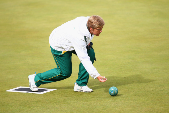 GLASGOW, SCOTLAND - AUGUST 01:  Colleen Piketh of South Africa bowls during the Women's Pairs Final against Jamie-Lea Winch and Natalie Melmore of England at Kelvingrove Lawn Bowls Centre during day nine of the Glasgow 2014 Commonwealth Games on August 1, 2014 in Glasgow, United Kingdom.  (Photo by Paul Gilham/Getty Images)