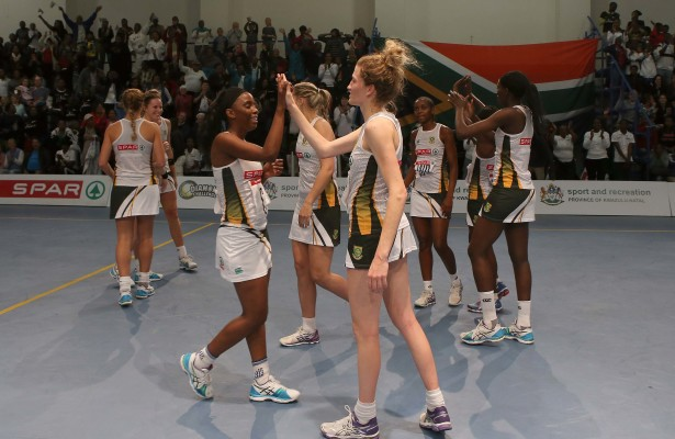 """MARGATE, SOUTH AFRICA - JUNE 17: Nokubonga Sabiya and Karla Mostert of South Africa give each other a """"high 5"""" after winning against Malawi during day 2 of the Diamond Challenge netball tournament at UGU Sports Centre on June 17, 2015 in Margate, South Africa. (Photo by Reg Caldecott/Gallo Images)"""
