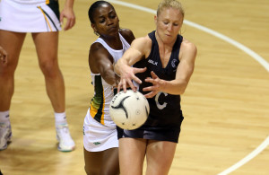 28.07.2015 Silver Ferns Laura Langman and South Africa's Precious Mthembu in action during the Silver Fern v South Africa netball test match played at Trusts Arena in Auckland. Mandatory Photo Credit ©Michael Bradley.