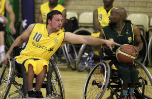 left to right  Kyle Louw(gold) and Gift Mooketsi (green) during Gold team and Green team match, 08 August 2015,Wheelchair Basketball , Mandeville club, Johannesburg, Gauteng Province, South Africa, Photo by Abbey Sebetha / Bakonepix