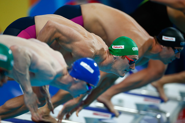 KAZAN, RUSSIA - AUGUST 02:  Cameron van der Burgh of South Africa dives to start the Men's 100m Breaststroke Semifinals on day nine of the 16th FINA World Championships at the Kazan Arena on August 2, 2015 in Kazan, Russia.  (Photo by Clive Rose/Getty Images)