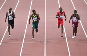 """Canada's Aaron Brown, South Africa's Anaso Jobodwana, Trinidad and Tobago's Kyle Greaux and Qatar's Femi Ogunode compete in a heat of the men's 200 metres athletics event at the 2015 IAAF World Championships at the """"Bird's Nest"""" National Stadium in Beijing on August 25, 2015.  AFP PHOTO / PEDRO UGARTE        (Photo credit should read PEDRO UGARTE/AFP/Getty Images)"""