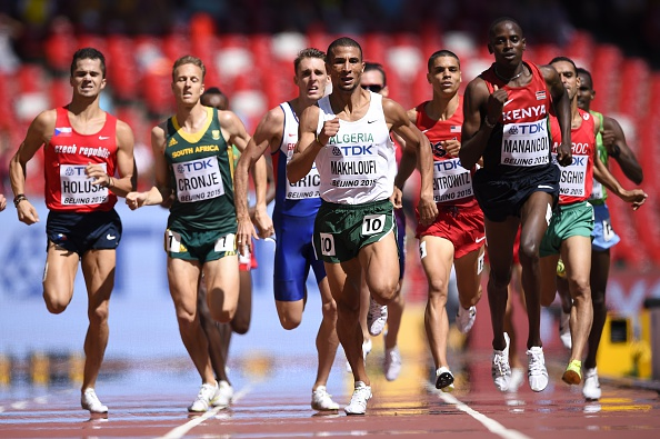 """(L-R) Czech Republic's Jakub Holusa, South Africa's Johan Cronje, Algeria's Taoufik Makhloufi and Kenya's Elijah Motonei Manangoi compete in a heat of the men's 1500 metres athletics event at the 2015 IAAF World Championships at the """"Bird's Nest"""" National Stadium in Beijing on August 27, 2015. AFP PHOTO / OLIVIER MORIN        (Photo credit should read OLIVIER MORIN/AFP/Getty Images)"""