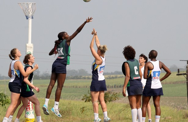 MARGATE, SOUTH AFRICA - AUGUST 26: Yolande du Preez of Gauteng shoots for goal with Phumza Maweni of Western Cape A1 defending during day 3 of the SPAR National Netball Championship at Ugu Sports Centre on August 26, 2015 in Margate, South Africa. (Photo by Reg Caldecott/Gallo Images)