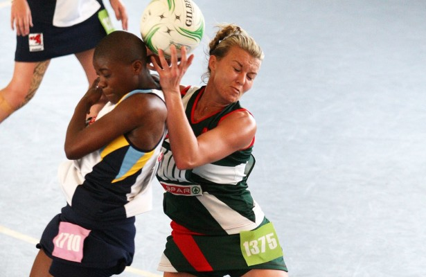 MARGATE, SOUTH AFRICA - AUGUST 24: Nadia Uys of North West (R) and Lungile Mthembu of Gauteng compete for the ball during day 1 of the SPAR National Netball Championship at Ugu Sports Centre on August 24, 2015 in Margate, South Africa. (Photo by Reg Caldecott/Gallo Images)