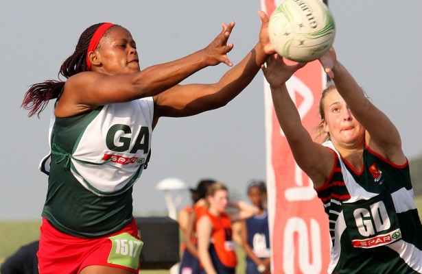 MARGATE, SOUTH AFRICA - AUGUST 27: Vuvu Nodludlume of Eastern Cape (L) and Jeante Strydom of North West compete for the ball during day 4 of the SPAR National Netball Championship at Ugu Sports Centre on August 27, 2015 in Margate, South Africa. (Photo by Reg Caldecott/Gallo Images)