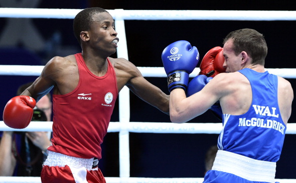 South Africa's Ayabonga Sonjica (L) punches Wales' Sean McGoldrick during a Mens Bantam (56 kg) Quarter-Final boxing match at the 2014 Commonwealth Games in Glasgow, Scotland, on July 30, 2014. AFP PHOTO / ANDREJ ISAKOVIC        (Photo credit should read ANDREJ ISAKOVIC/AFP/Getty Images)