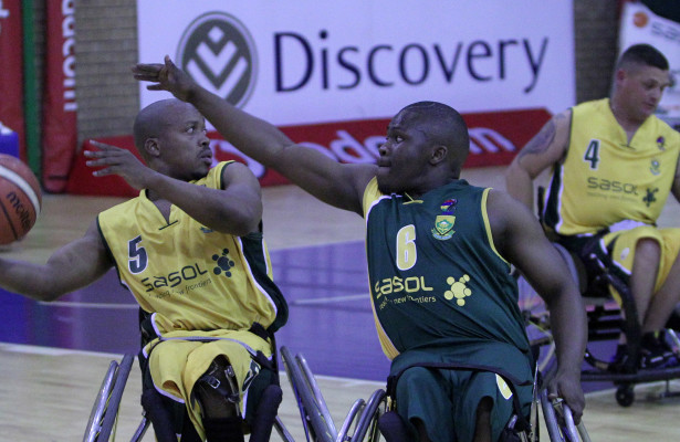left to right Jimmy Mamfengu (gold) and Lisolomzi Mazantsana (green) during Gold team and Green team match, 12 September 2015,Wheelchair Basketball , Mandeville club, Johannesburg, Gauteng Province, South Africa, Photo by Abbey Sebetha / Bakonepix