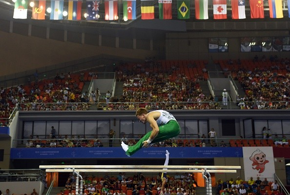 South Africa's Ryan Patterson performs on the parallel bars during the men's qualification at the Gymnastics World Championships in Nanning, in China's southern Guangxi province on October 3, 2014. AFP PHOTO/Greg BAKER        (Photo credit should read GREG BAKER/AFP/Getty Images)