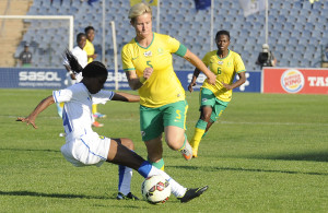 DOBSONVILLE, SOUTH AFRICA - MAY 31:  Janine Van Wyk of South Africa and Koumba Chimene of Gabon during the Olympic Qualifying match between Banyana Banyana and Gabon at Dobsonville Stadium on May 31, 2015 in Dobsonville, South Africa. (Photo by Lefty Shivambu/Gallo Images)