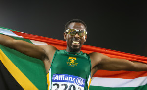 DOHA, QATAR - OCTOBER 29:  Jonathan Ntutu of South Africa celebrates winning silver in the men's 200m T12 final during the Evening Session on Day Eight of the IPC Athletics World Championships at Suhaim Bin Hamad Stadium on October 29, 2015 in Doha, Qatar.  (Photo by Francois Nel/Getty Images)