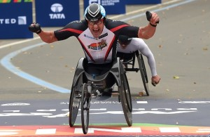 Ernst Van Dyk from South African crosses  the finish line to win the Men's Wheelchair division of the TCS New York City Marathon in New York November 1, 2015.  AFP PHOTO / TIMOTHY A. CLARY        (Photo credit should read TIMOTHY A. CLARY/AFP/Getty Images)