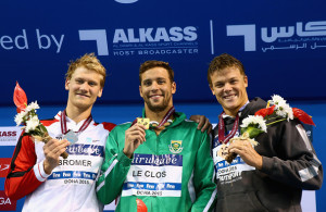 DOHA, QATAR - NOVEMBER 02:  Victor Bromer of Denmark, Chad Le Clos of South Africa and Christopher Wright of Australia  celebrate on the podium after the Men's 200m Butterflyfinal during day one of the FINA World Swimming Cup 2015 at the Hamad Aquatic Centre on November 2, 2015 in Doha, Qatar.  (Photo by Francois Nel/Getty Images)