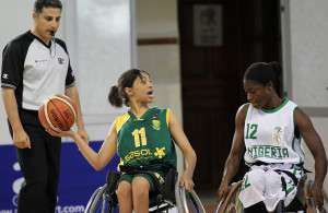 SA player Misqah Kamaldien and Nigeria opponen Kemi Oluwasegun during nternational Wheelchair Basketball Federation's African Qualifiers in Algiers, Staoueli Basketball Stadium from 31 October to 7 November, if they are to book a spot at the 2016 Rio Paralympics, Photo by Abbey Sebetha / Bakonepix