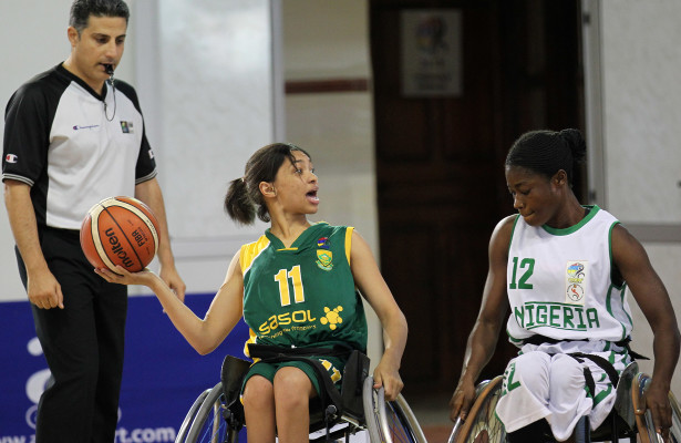 SA player Misqah Kamaldienand Nigeria opponen Kemi Oluwasegun during nternational Wheelchair Basketball Federation's African Qualifiers in Algiers, Staoueli Basketball Stadium from 31 October to 7 November, if they are to book a spot at the 2016 Rio Paralympics, Photo by Abbey Sebetha / Bakonepix