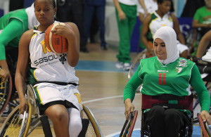 SA player Duduzile Ntombiyenko and Algeria player Dahbia Zaira during nternational Wheelchair Basketball Federation's African Qualifiers in Algiers, Staoueli Basketball Stadium from 31 October to 7 November, if they are to book a spot at the 2016 Rio Paralympics, Photo by Abbey Sebetha / Bakonepix