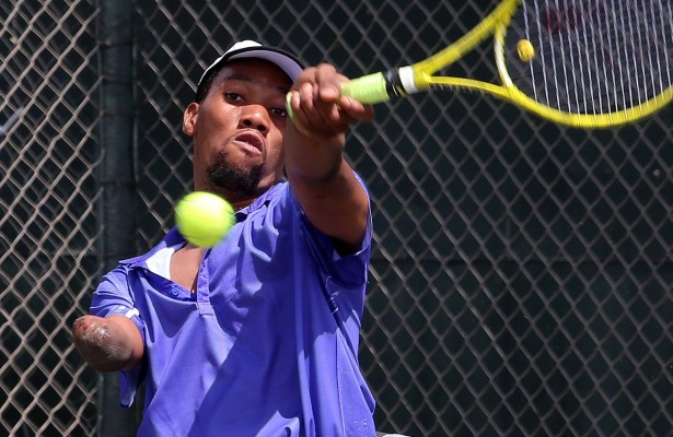 JOHANNESBURG, SOUTH AFRICA – DECEMBER 17: Lucas Sithole of South Africa in action against  Haim Lev (ISR) in the quads final during day 4 of the ACSA Joburg Open at Ellis Park Tennis Stadium on December 17, 2015 in Johannesburg, South Africa. (Photo by Reg Caldecott/Gallo Images)