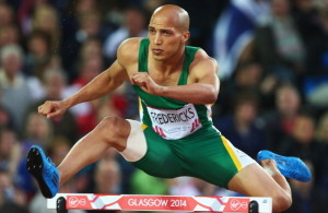 GLASGOW, SCOTLAND - JULY 31:  Cornel Fredericks of South Africa on his way to winning gold in the Men's 400 metres hurdles final at Hampden Park during day eight of the Glasgow 2014 Commonwealth Games on July 31, 2014 in Glasgow, United Kingdom.  (Photo by Paul Gilham/Getty Images)