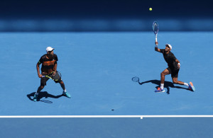 MELBOURNE, AUSTRALIA - JANUARY 25:  Raven Klaasen of South Africa and Rajeev Ram of the United States comepete in their third round match against Bob Bryan and Mike Bryan of the United States during day eight of the 2016 Australian Open at Melbourne Park on January 25, 2016 in Melbourne, Australia.  (Photo by Darrian Traynor/Getty Images)