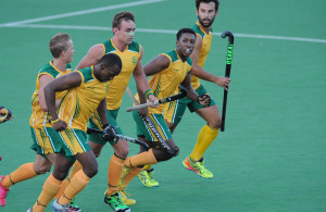 CAPE TOWN, SOUTH AFRICA - JANUARY 20: Daniel Bell of South Africa celebrates scoring the equaliser with team mates during the Hartleyvale Summer Series match between South Africa and Spain at Hartleyvale Hockey Stadium on January 20, 2016 in Cape Town, South Africa. (Photo by Ashley Vlotman/Gallo Images)