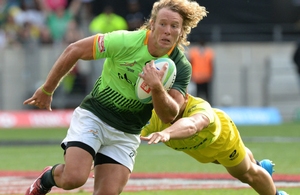 PORT ELIZABETH, SOUTH AFRICA - DECEMBER 14: Werner kok of South Africa runs in for his try during day 2 of the Cell C Nelson Mandela Bay Sevens Series at Nelson Mandela Bay Stadium on December 14, 2014 in Port Elizabeth, South Africa. (Photo by Duif du Toit/Gallo images)