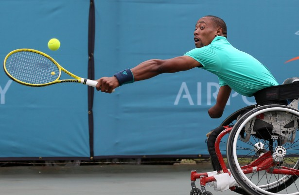 JOHANNESBURG, SOUTH AFRICA - APRIL 06: Lucas Sithole, the third seed of South Africa in action against Heath Davidson (AUS) in the quads singles during day 2 of the ACSA SA Wheelchair Tennis Open at the Ellis Park Tennis Stadium on April 06, 2016 in Johannesburg, South Africa. (Photo by Reg Caldecott/Gallo Images)