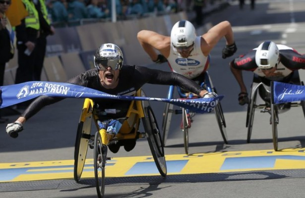 Marcel Hug of Switzerland crosses the finish line ahead of Kurt Fearnley of Australia (C) and Ernst Van Dyk of South Africa (R) to win the men's wheelchair division of the 120th Boston Marathon in Boston, Massachusetts April 18, 2016.  REUTERS/Brian Snyder