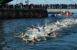 The elite men swin in the V&A Waterfront during the Discovery World Triathlon series in Cape Town. Image by Greg Beadle