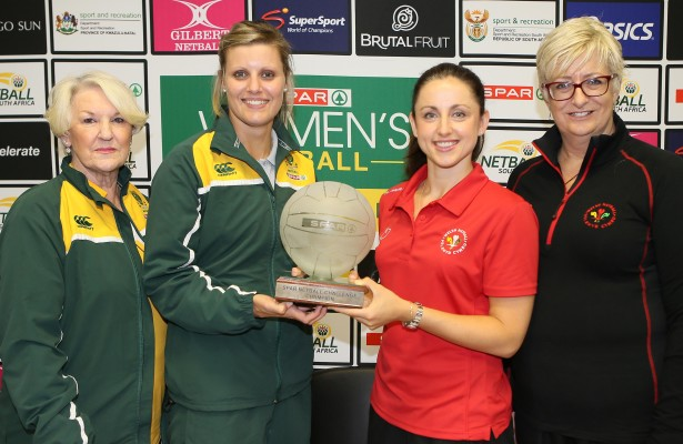 DURBAN, SOUTH AFRICA - JUNE 16: Norma Plummer (Protea head coach), Maryka Holtzhausen (Protea captain), Suzy Drane (Wales captain) and Trish Wilcox (Wales head coach) with the Spar Challenge trophy during the Spar Netball Challenge press conference prior to the series between South Africa and Wales at Marine Parade Garden Court on June 16, 2016 in Durban, South Africa. (Photo by Reg Caldecott/Gallo Images)