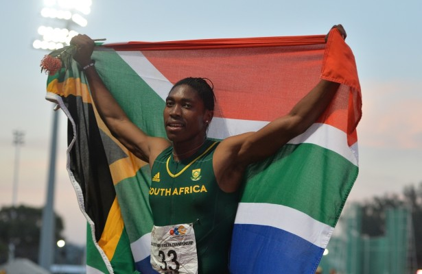 DURBAN, SOUTH AFRICA - JUNE 26: Caster Semenya celebrates another 800m title holding up the South African flag during the afternoon session on day 5 of the CAA 20th African Senior Championships at Kings Park Athletic stadium on June 26, 2016 in Durban, South Africa. (Photo by Roger Sedres/Gallo Images)