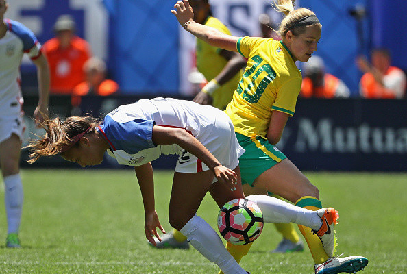 CHICAGO, IL - JULY 09: Mallory Pugh #2 of the United States takes the ball away from Stephanie Malherbe #20 of South Africa during a friendly match at Soldier Field on July 9, 2016 in Chicago, Illinois. (Photo by Jonathan Daniel/Getty Images)