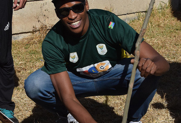 BENONI, SOUTH AFRICA. 22 JULY 2016. Members of Team SA visited the Usizolwethu School for Special Needs in Daveyton planting trees and distributing food to the pupils. The team leaves for the Rio 2016 Olympic Games on Saturday evening.  Long jumper Luvo Manyonga.   Copyright picture by WESSEL OOSTHUIZEN / SASPA