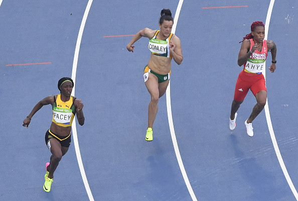 (LtoR) Jamaica's Simone Facey, South Africa's Alyssa Conley and Trinidad and Tobago's Michelle-Lee Ahye compete in the Women's 200m Round 1 during the athletics event at the Rio 2016 Olympic Games at the Olympic Stadium in Rio de Janeiro on August 15, 2016.   / AFP / Fabrice COFFRINI        (Photo credit should read FABRICE COFFRINI/AFP/Getty Images)