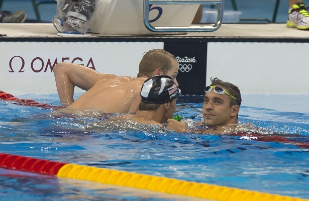 Michael Phelps celebrates is congratulated by South Africa's Chad le Clos after his victory and reclaims the Gold medal at the Rio Olympic games. RIO DE JANEIRO, BRAZIL - AUGUST 09:  Day 4 on Day 4 of the Rio 2016 Olympic Games at the Olympic Aquatics Stadium on August 9, 2016 in Rio de Janeiro, Brazil. (Photo by ©Christiaan Kotze/SASPA