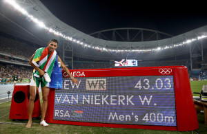 RIO DE JANEIRO, BRAZIL - AUGUST 14:  Wayde van Niekerk of South Africa celebrates after winning the Men's 400 meter final and setting a new world record of 43.03 on Day 9 of the Rio 2016 Olympic Games at the Olympic Stadium on August 14, 2016 in Rio de Janeiro, Brazil.  (Photo by Cameron Spencer/Getty Images)