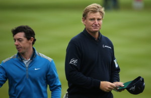 VIRGINIA WATER, ENGLAND - MAY 23:  Rory McIlroy of Northern Ireland and Ernie Els of South Africa (R) complete their rounds on the 18th green during day two of the BMW PGA Championship at Wentworth on May 23, 2014 in Virginia Water, England.  (Photo by Warren Little/Getty Images)