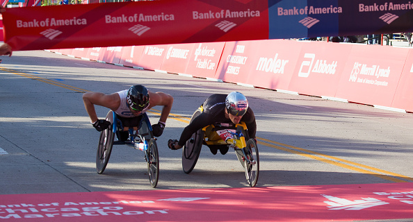 CHICAGO, IL - OCTOBER 09:  Kurt Fearnley of Australia second place winner and Marcel Hug of Switzerland first place winner in the mens wheelchair race at the Bank of America Chicago Marathon on October 9, 2016 in Chicago, Illinois.  (Photo by Tasos Katopodis/Getty Images)