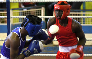 LUANDA, ANGOLA - DECEMBER 11: South Africa's Mxolisi Zuma (red vest) and Botswana's Tshepo Mbwe during the boxing event on day 3 of the 2016 Africa Union Sports Council Region 5 Games on December 11, 2016 in Luanda, Angola. (Photo by Wessel Oosthuizen/Gallo Images)