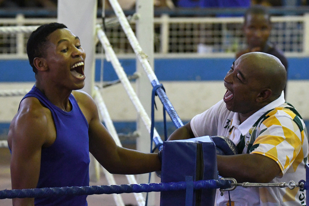 LUANDA, ANGOLA - DECEMBER 14: Uyanda Nogogo (L) and coach Mlandeli Mnqibisa during of the boxing finals on day 6 of the 2016 Africa Union Sports Council Region 5 Games on December 15, 2016 in Luanda, Angola. (Photo by Wessel Oosthuizen/Gallo Images)