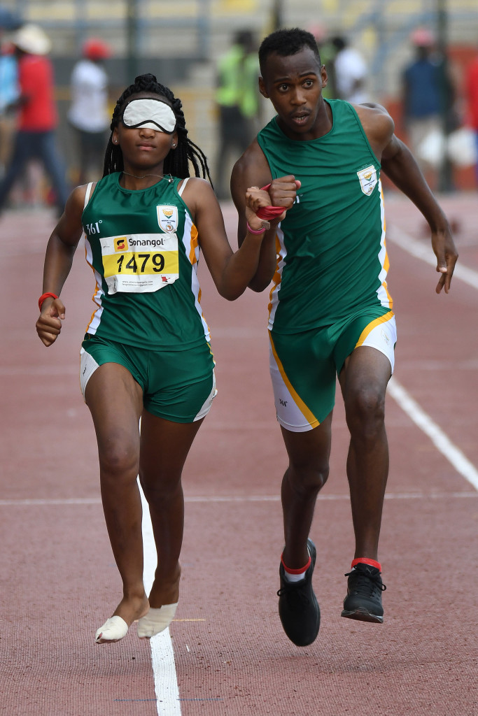 LUANDA, ANGOLA - DECEMBER 12: Sinelethu Nyanda and her guide Ricardo Gatyana during the athletics on day 4 of the 2016 Africa Union Sports Council Region 5 Games on December 12, 2016 in Luanda, Angola. (Photo by Wessel Oosthuizen/Gallo Images)
