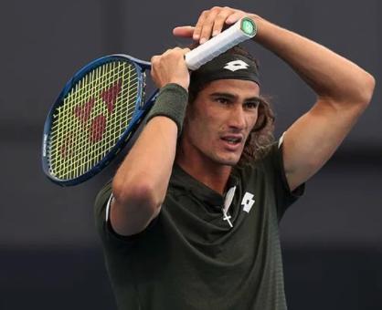 Harris moves into quarter-finals in Dubai